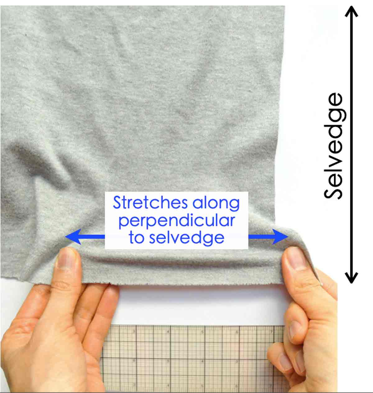 Shows hands pulling on 2 way stretch knit in horizontal direction