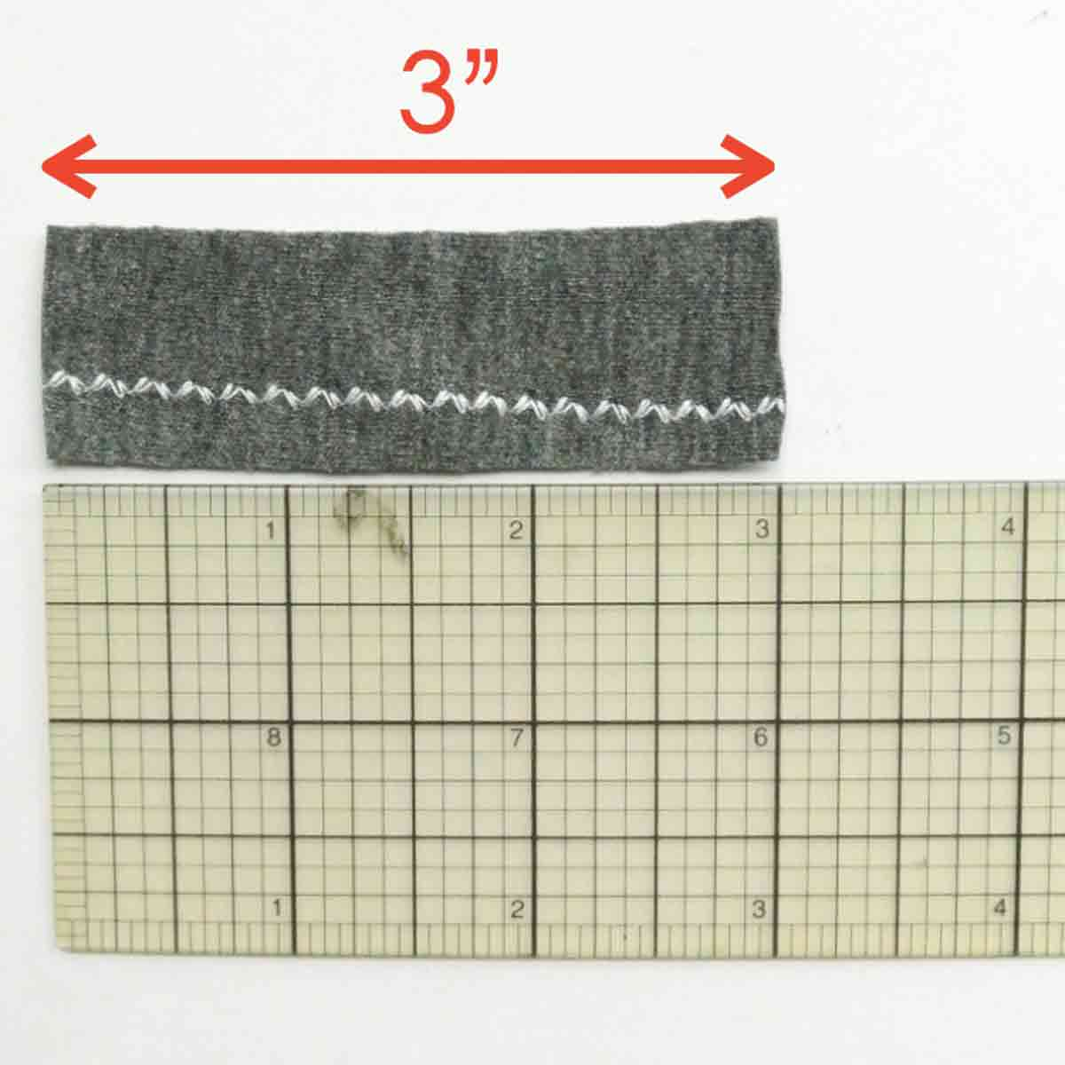 Reinforced zigzag stitch over ruler measuring 3 inches