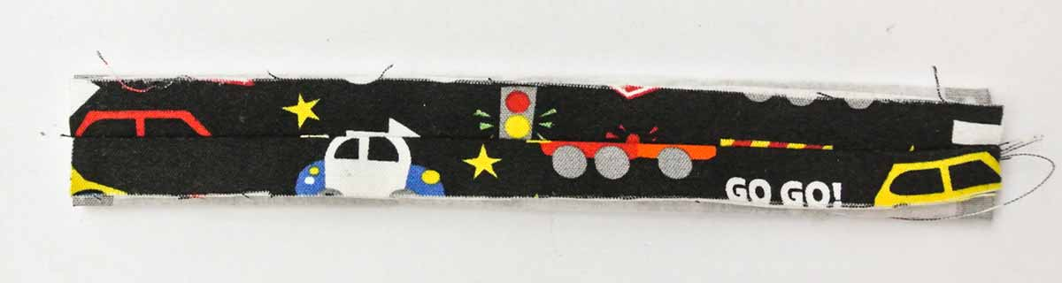 Pressing open seam of handle. DIY toy car carrier wallet play mat tutorial
