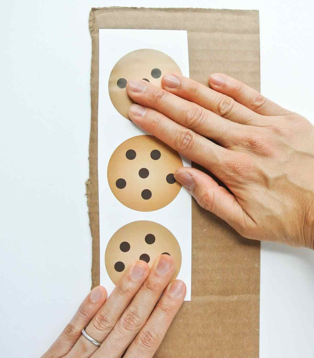 Gluing toddler cookie counting activity free printable onto cardboard