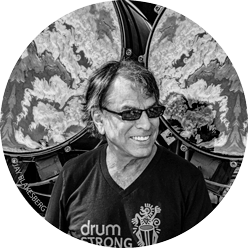Image of Mickey Hart in front of drums