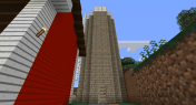 The grain silo has a radius of 3.5 block (a diameter of 7 blocks). That's a fir door leading inside.
