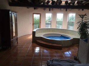 This is the room with the floor we will be removing, starting on the left of the hot tub and going in a half-circle.
