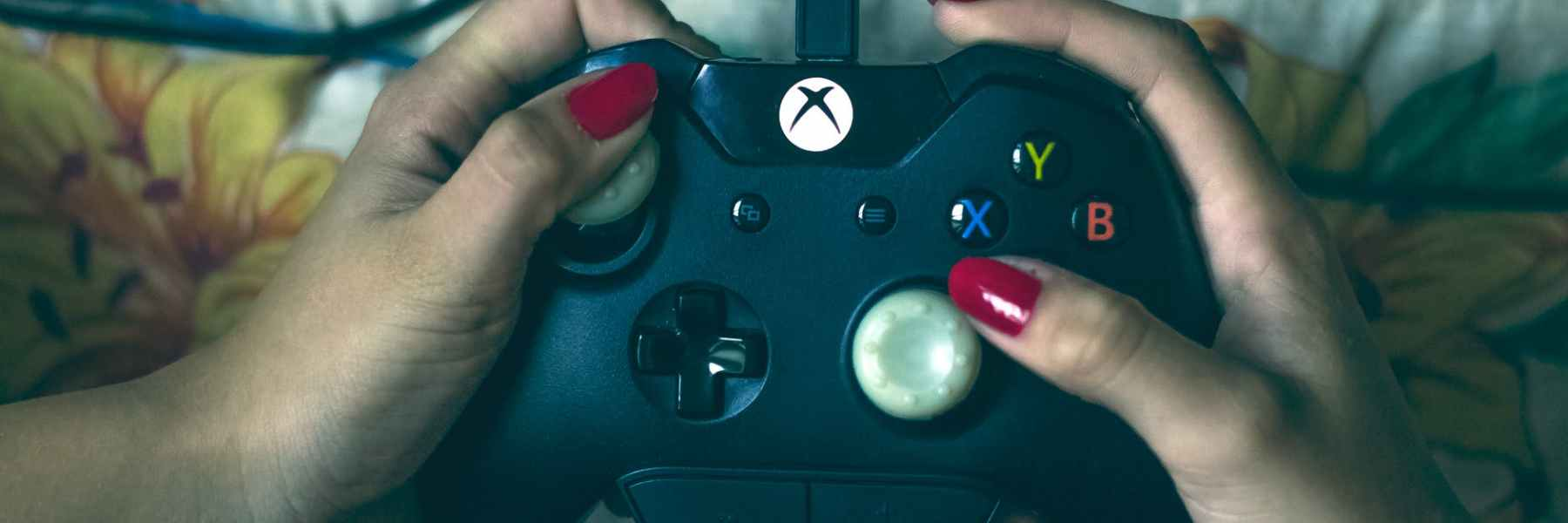 person holding microsoft xbox one controller
