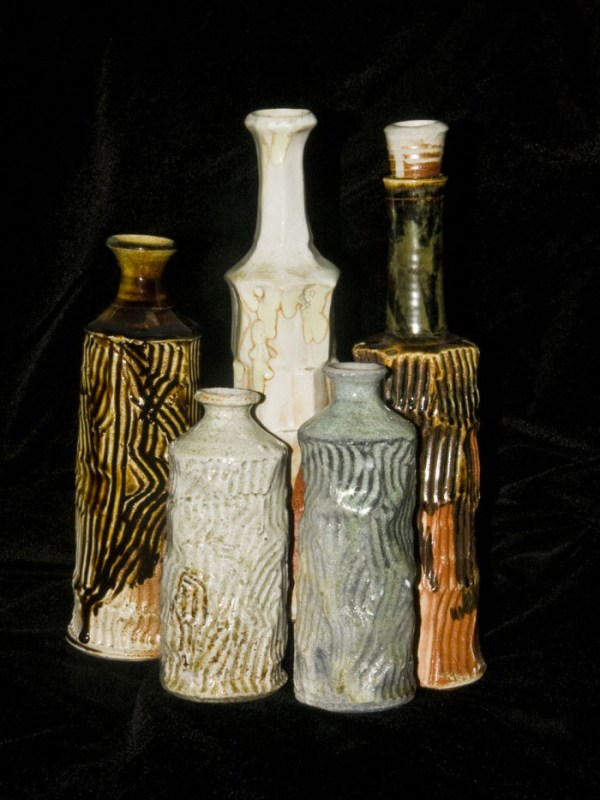 Wood fired bottles glazed in wood ash, temoku and celedon