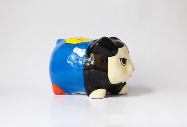 Superhero-themed handmade ceramic piggy bank