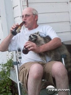 This-is-my-uncle-from-Idaho-drinking-a-beer-with-his-pet-raccoon-named-Mr-T