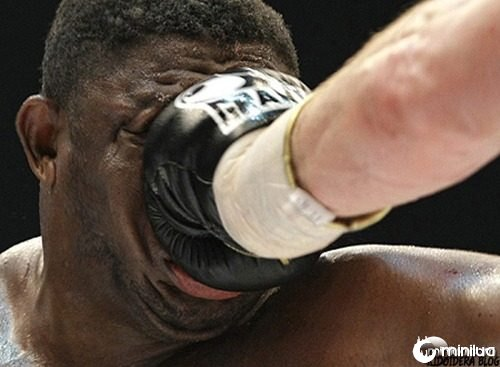 Samuel Peter from Nigeria gets a punch from Vitali Klitschko of Ukraine during their WBC heavyweight boxing world championship fight in Berlin, Germany, Saturday, Oct. 11, 2008. Klitschko won the fight after round nine due to technical knock out. (AP Photo/Herbert Knosowski)