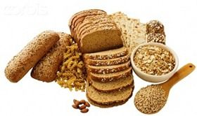 Close up of assorted grains and bread --- Image by © Tetra Images/Corbis