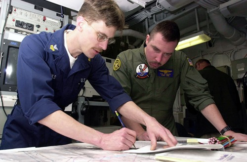 030115-N-1577S-002<br /><br /> ABOARD USS NIMITZ (CVN-68) January 15,2003<br /><br /> United States Naval Reservist Signalman 1st Class Chad Brooks of Port Orchard, Wash., conducts submarine water space management training with Aviation Warfare Systems Operator 2nd Class Charles Stanley of Wilmington, N.C,. aboard Nimitz. Nimitz is currently undergoing Composite Unit Training Exercise (COMPTUEX) off the coast of San Diego, Calif. U.S. Navy Photo by PHAA Timothy Sosa<br /><br />