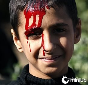 A Shi'ite Muslim boy is pictured with blood on his head as he takes part during the Muharram procession to mark Ashura in Beirut