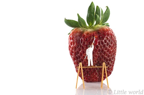 painter on gauntree painting the strawberries red