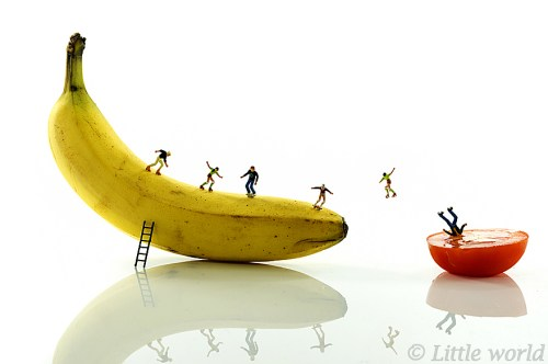 skating little people on yelllow banana