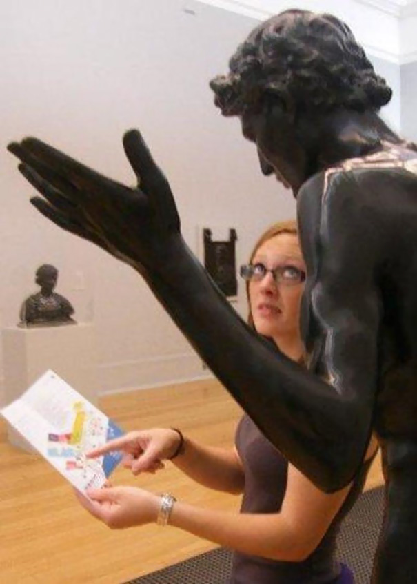 People Playing With Statue