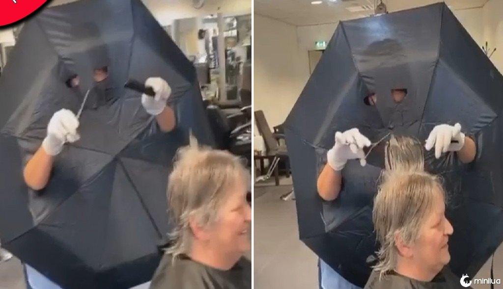 Cabeleireira corta buracos no guarda-chuva para braços e olhos como barreira entre clientes | Minilua