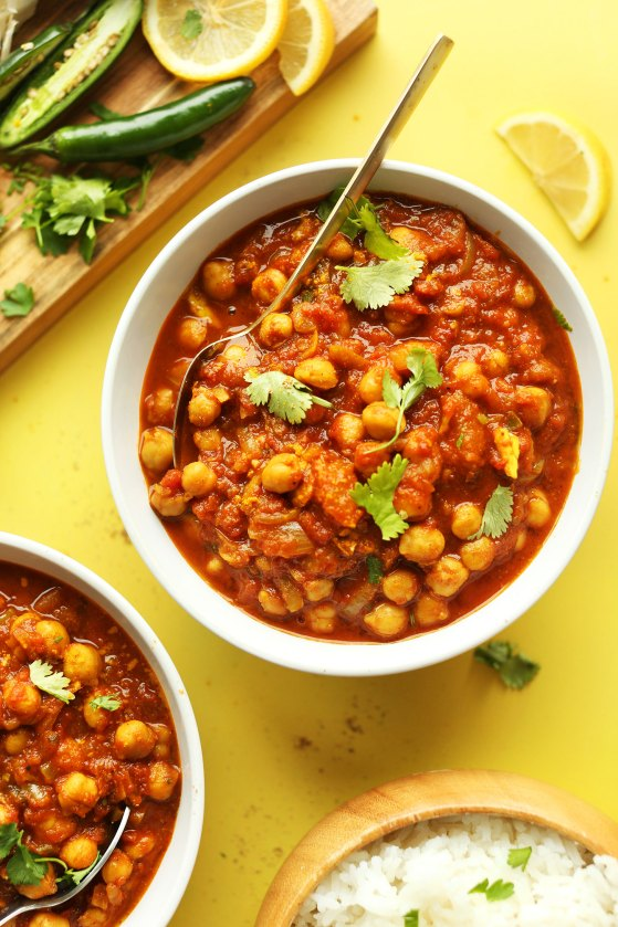 Bowls of our homemade gluten-free vegan Chana Masala recipe with rice, jalapeno, and lemons