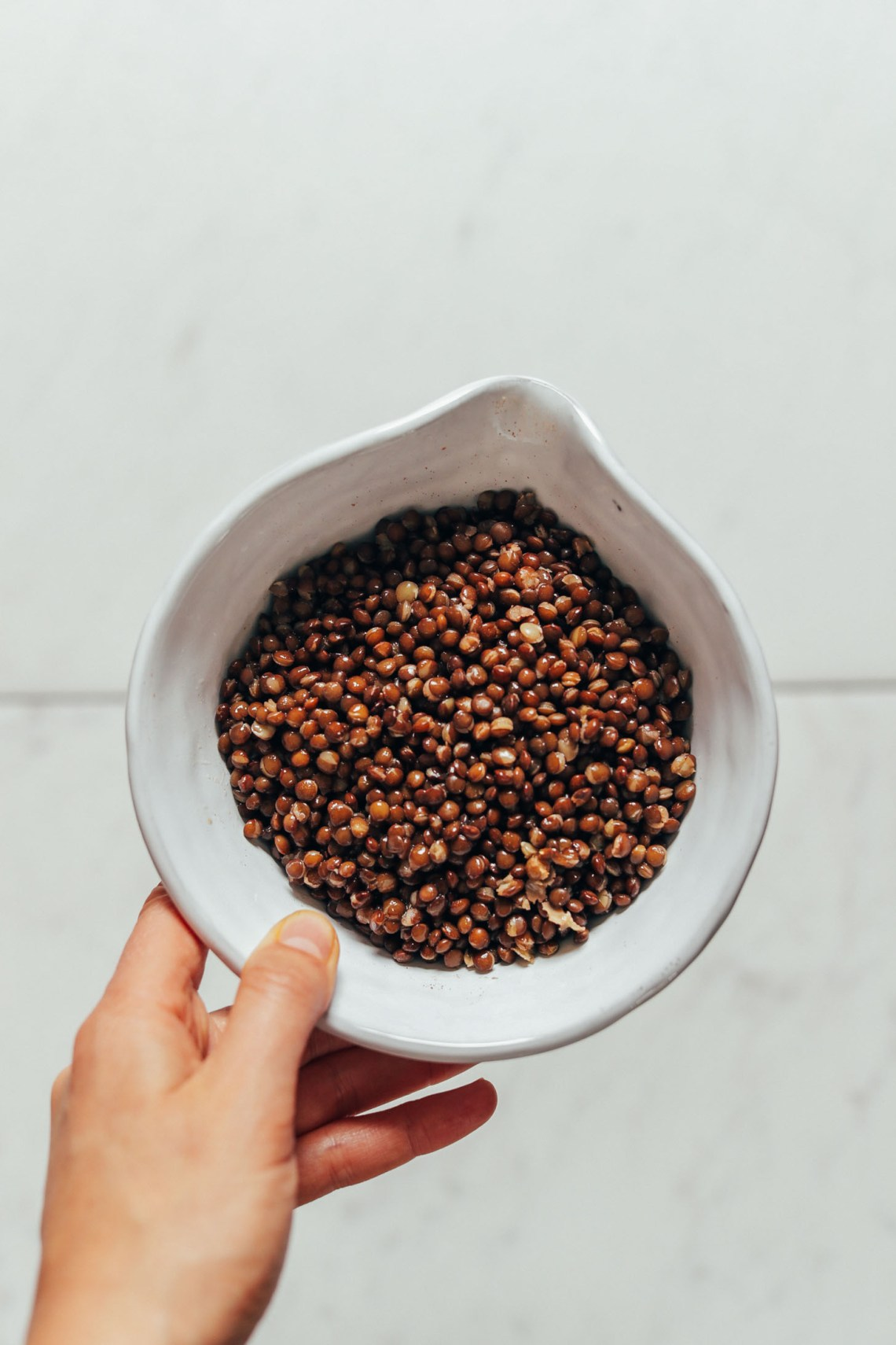 Bowl of cooked lentils for making our Smoky Refried Lentils recipe