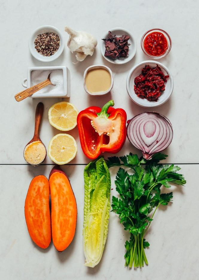 Parsley, romaine, sweet potato, red onion, bell pepper, lemon, hummus, sauerkraut, tahini, salt, za'atar, chili garlic sauce, dulse, and garlic
