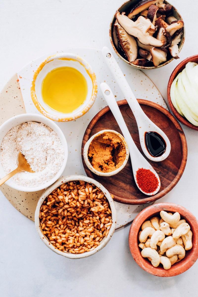 Brown rice, oat flour, avocado oil, mushrooms, onion, cashews, miso, coconut aminos, and paprika