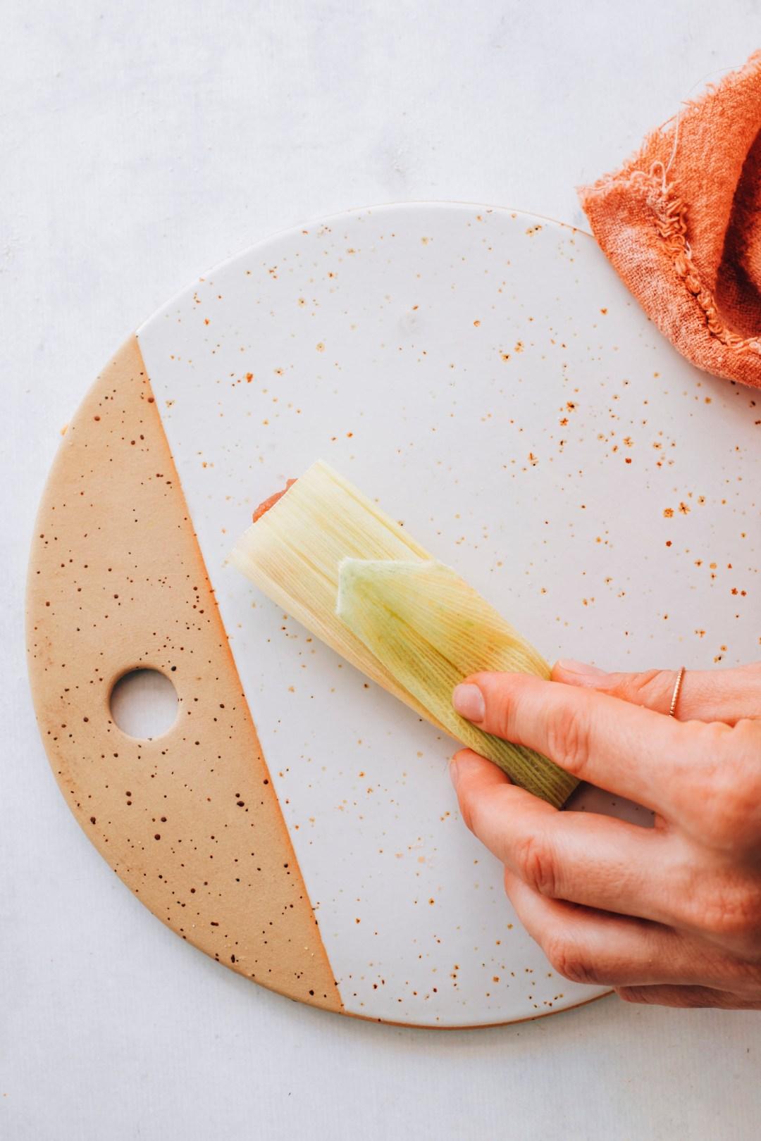 Showing a folded corn husk