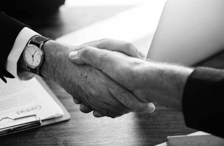 dream job interview handing hands