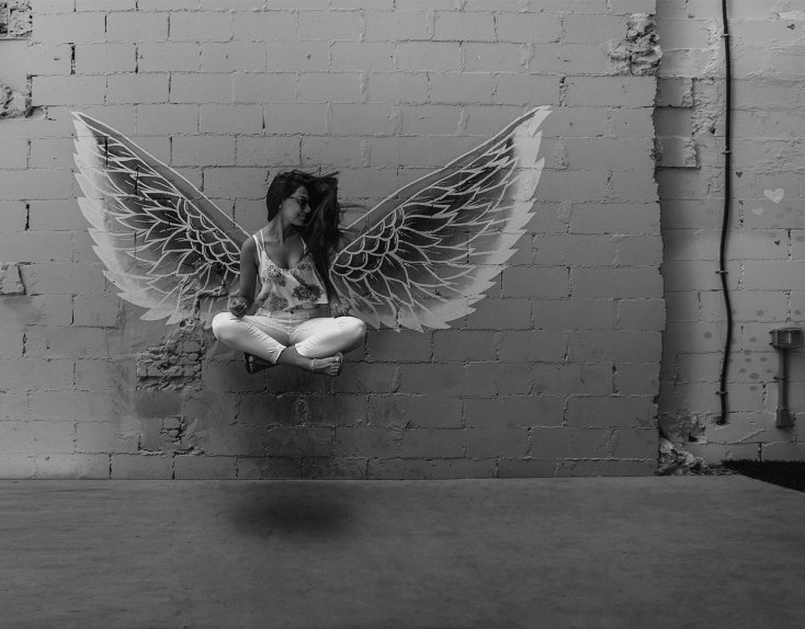 girl floating free with wings