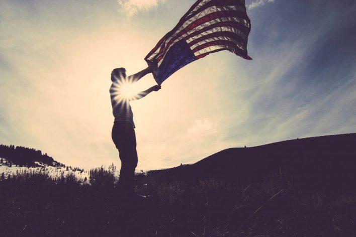 American Flag against Sunset