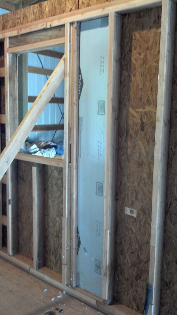 Putting in the first layer of insulation