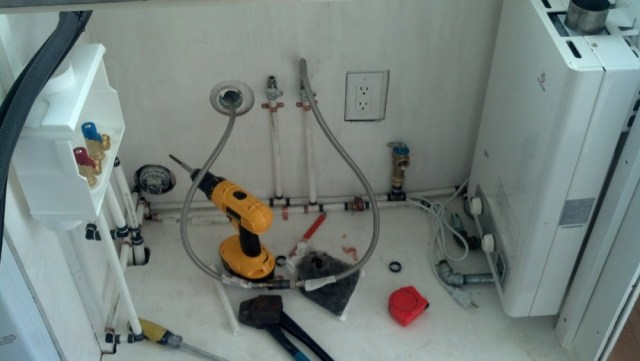 The 'mechanical room' (under the kitchen sink)