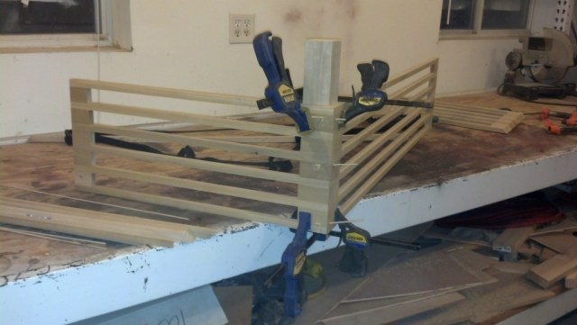 Putting the rails together at a perfect 90 degree angle was done with a square block of wood and some clamps