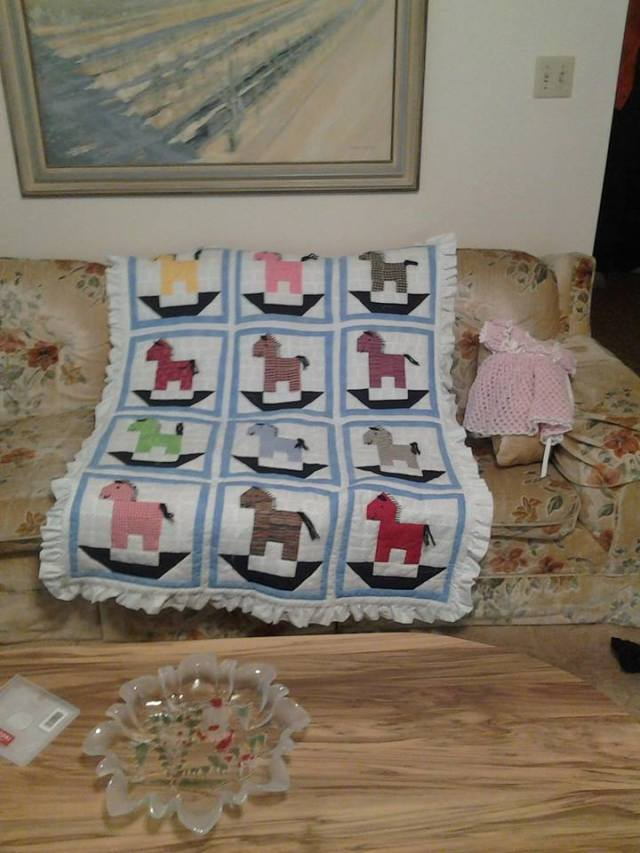 Not only does MiniM have a home-made quilt from my mom, my grandmother ALSO made her one, with poonies!  (and a cute little dress)