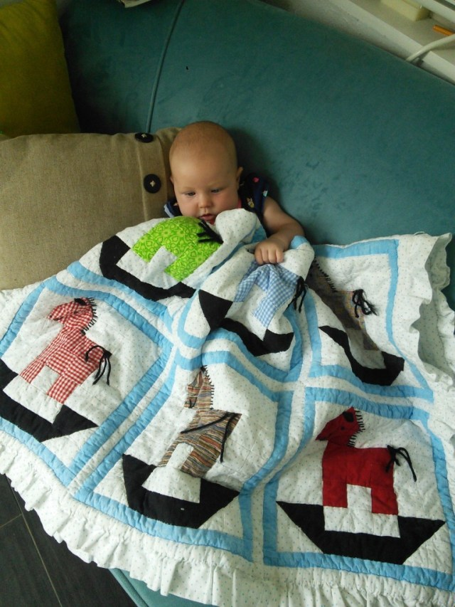 She loves the quilt that great grandma made her and spends a bit of time chilin on the couch