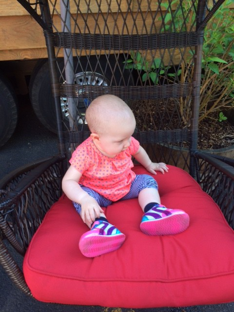 Trying out the hanging chair at the Caravan Tiny House hotel