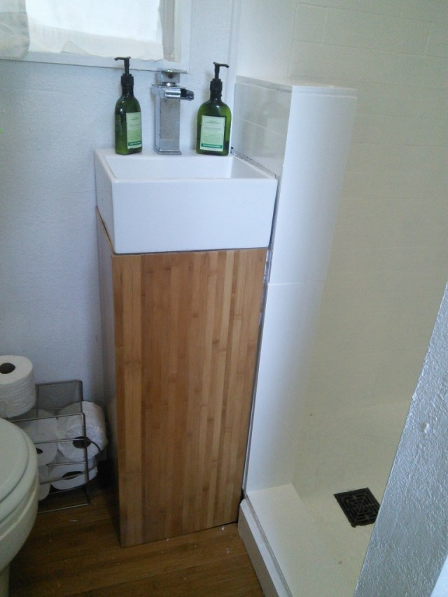 The new bathroom sink, this used to be the dark birch wood, swapped out for bamboo