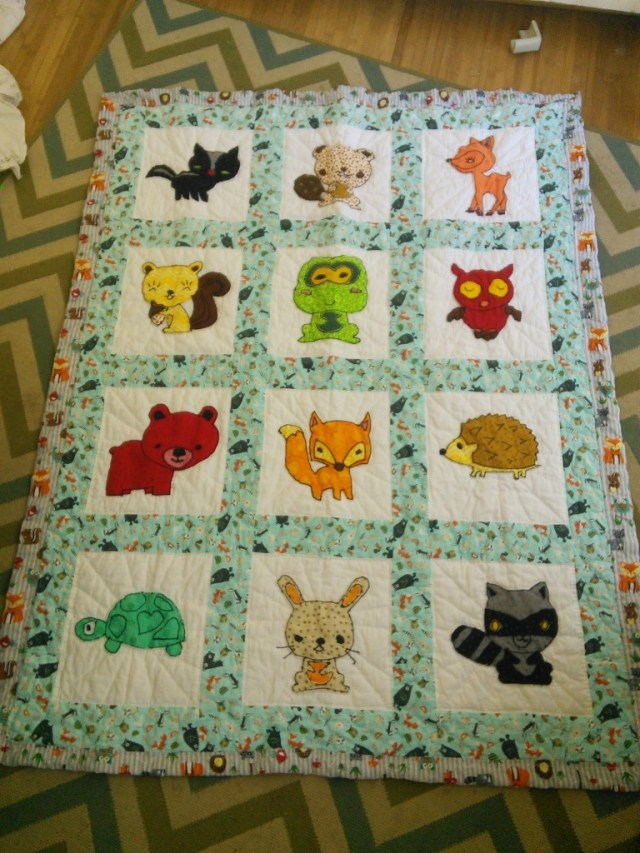 THIS is the finished quilt that mom made for Mr. T(iny), he got woodland creatures!