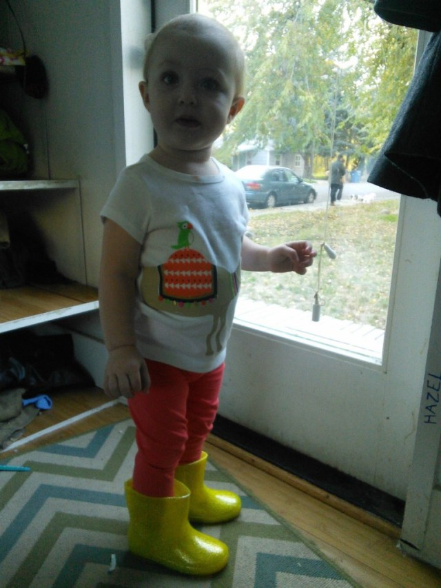 He costume would have been AWESOME if her boots would have come in time, now shes just got awesome rain boots