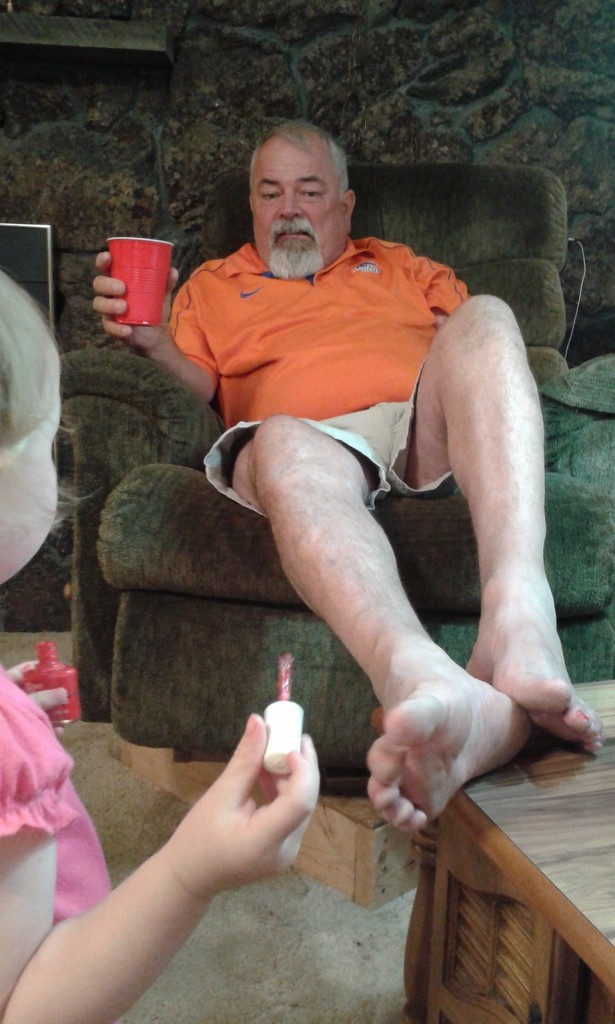 Then she painted poppys toes, bright red!