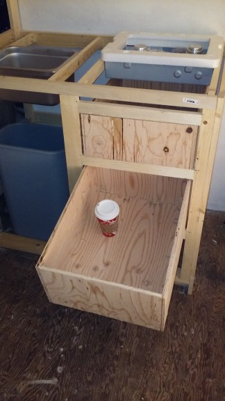 "I built the drawers out of 1/2"" plywood, screwed together with a kreg jig (very simple!"