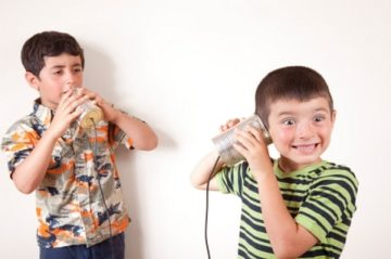 Kids talking on a tin can phone