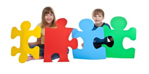Kids holding large puzzle pieces