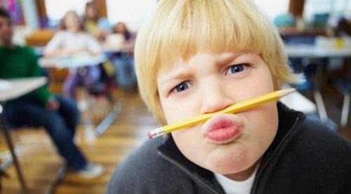disruptive boy in classroom