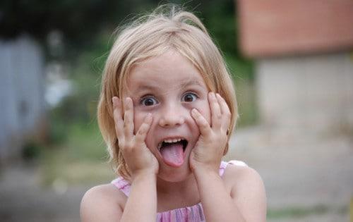 Little girl making afraid face