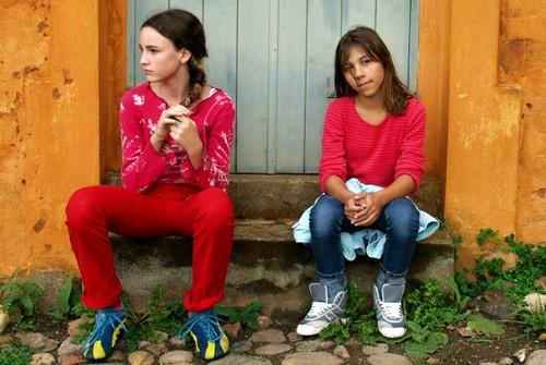 Two preteen girls hanging around