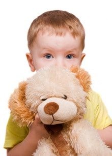 Shy boy with stuffed bear