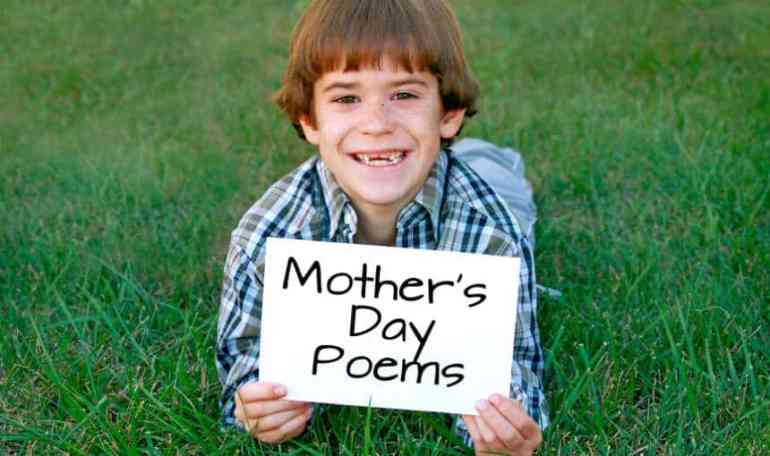 boy holding happy mother's day sign