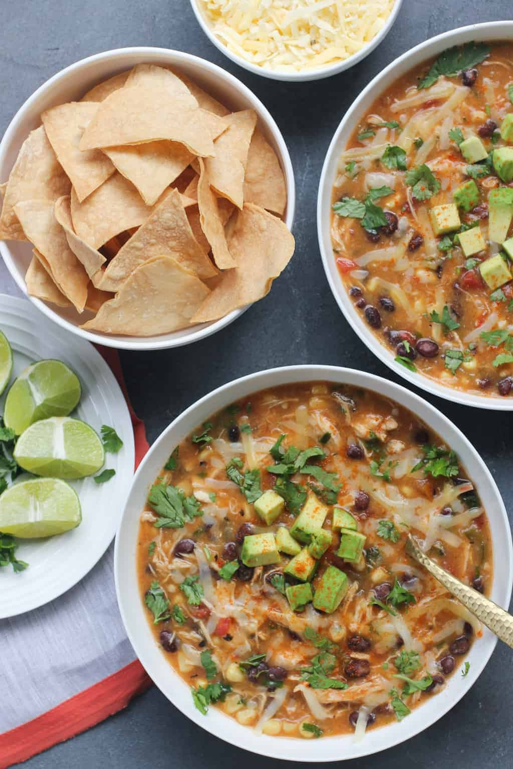 Chicken Tortilla Soup - Aspicy and comforting Mexican soup that is loaded with tender cooked chicken, beans, fire-roasted tomatoes, corn and smokey peppers.Dress it up with your favorite toppings and serve with crunchy tortilla chips for a meal that the whole family can enjoy.