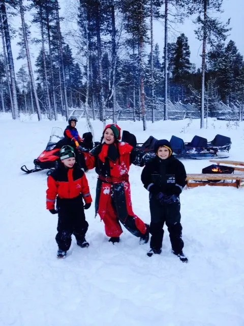 Playing in the snow with elves on our family adventure to Lapland