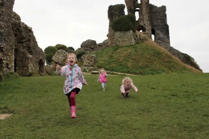 Children running, enjoying and exploring a National Trust day out in Dorset