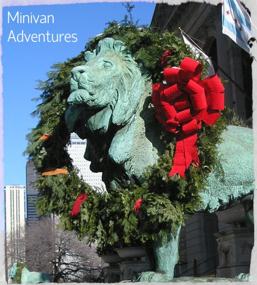 Even the lions outside the entrance to The Art Institute of Chicago get decked out for the holidays.
