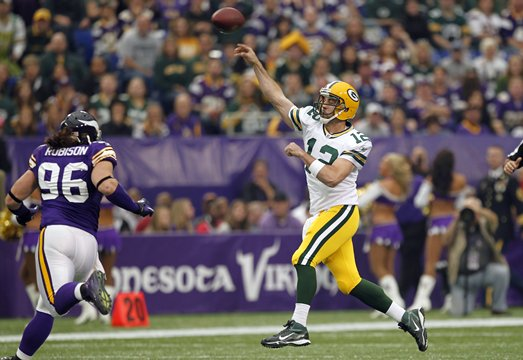 Photo of Aaron Rodgers Throwing A Pass Against The Vikings With Brian Robison In Pursuit